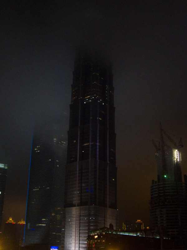 China-Shanghai-Pudong-Beef-Neon - A dark and sinister building dissapears into cloud. I never saw its top all evening.