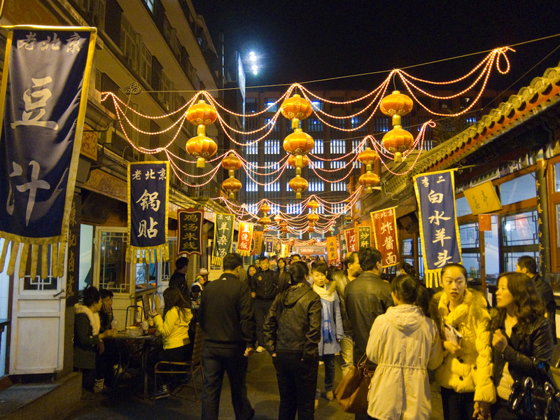 China-Beijing-Wangfujing-Dumplings - The lack of street lighting makes for some interesting store lighting, in this case bright yellow, but generally flickering fluoro style that you assu