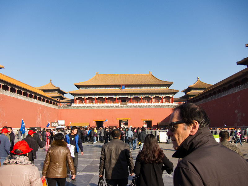 China-Beijing-Forbidden City - Entrance court, full of tour groups with blaring loudspeaker systems, flags, whistles etc. Some now have loudspeakers where they press a button and it