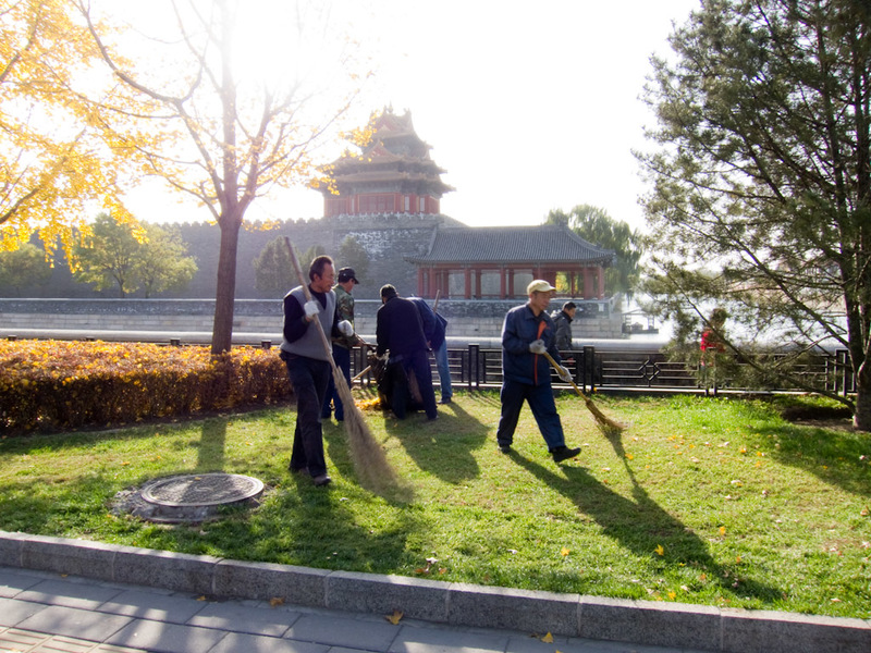 China-Beijing-Military-Museum-Beihai Park - An army of retired volunteers on leaf sweeping duty, they have their radio going and seem very happy.
