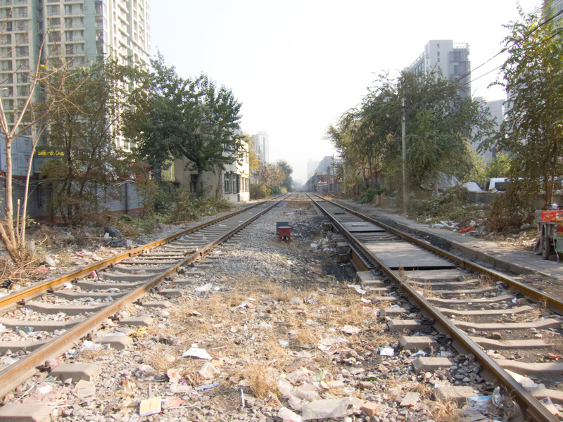 China-Beijing-Train - Working train tracks in the middle of a city.