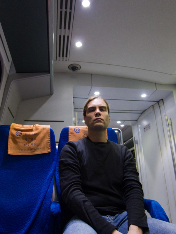 China-Beijing-Airport-Train-Lounge - Its me on the train, looking thrilled as usual. Actually I am, I am going to the airport!