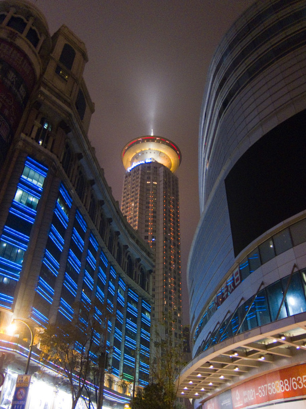 China-Shanghai-Nanjing Road-Dancing - Back in Shanghai, this place is right near my hotel, it looks great with the light shining up. I presume its a revolving restaurant.