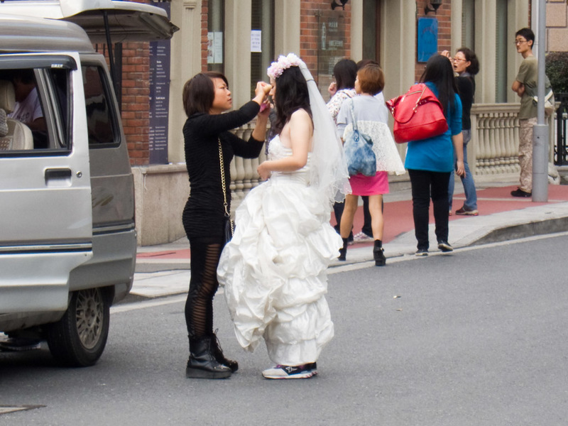 China-Shanghai-Xujiahui-Mall - This girl is getting married wearing sneakers.