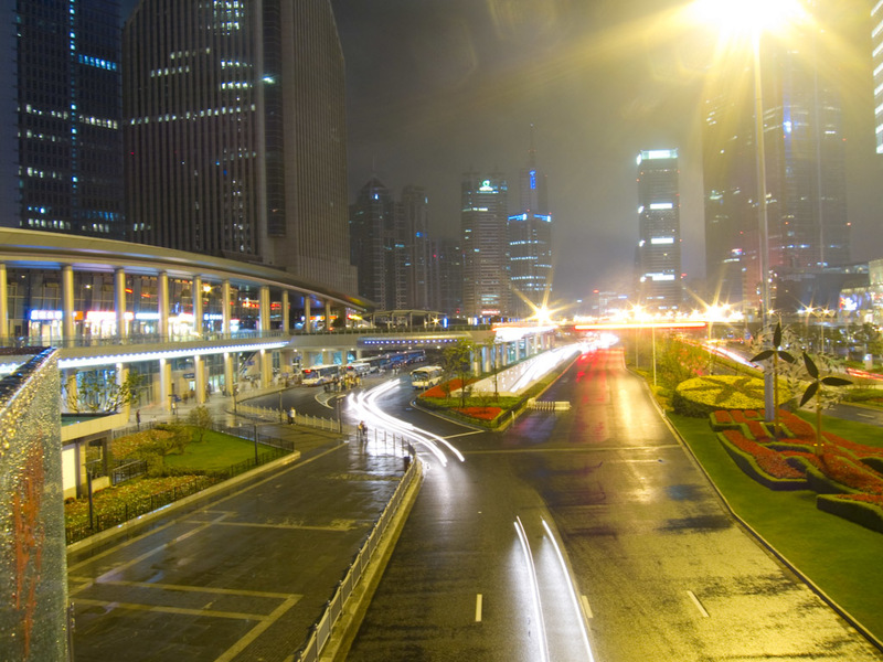 China-Shanghai-Pudong-Beef-Neon - Standing on one of the many pedestrian flyovers. It had just rained and the thousands of people dissapeared instantly. Everyone has a morbid fear of r
