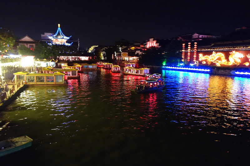 China-Nanjing-Mall-Canal - There is also more canals going around the area, with neon coated boats seemingly racing each other along them under all the old low bridges. The line