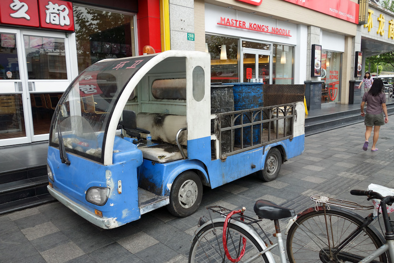 China-Shanghai-Station - OK, time to make this all a tax deduction. This is as far as I can tell a Chinese grease trap truck, the drums on the back seemed to have waste cookin