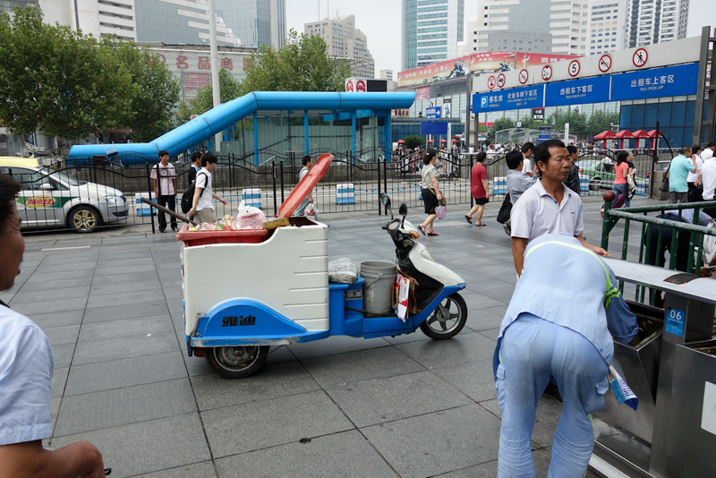 China-Shanghai-Station - Next up, the wheely bin electric transport scooter. The workers sort the recyclables on the spot, no need for sorting at recycling centres etc. OK, th