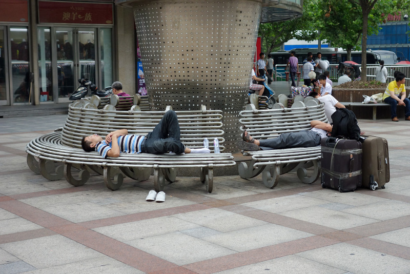 China-Shanghai-Station - Despite warnings that pickpockets can remove your wedding ring with chopsticks without you even noticing, a large number of people have no issue sleep