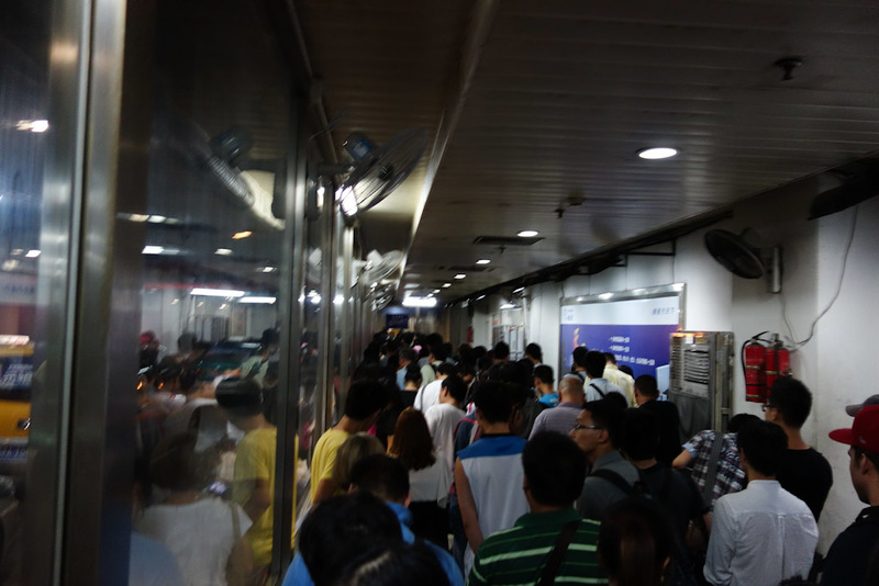 China-Nanjing-Hangzhou-Train - The taxi waiting tunnel. I am near the front of the queue by the time I took this photo, it was probably 100 metres long like this squeezed into this