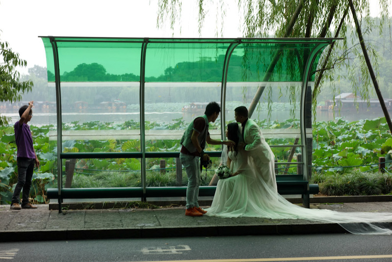 China-Hangzhou-West Lake-Fog - OK, this is a different wedding. But they have decided to have their photos taken in a bus stop. I can only hope the reason is this is where they met,