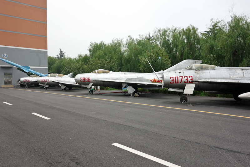 China-Shanghai-Museum-Amusement Park - The usual lineup of Korean war era mig fighters. China made them under license from Russia.