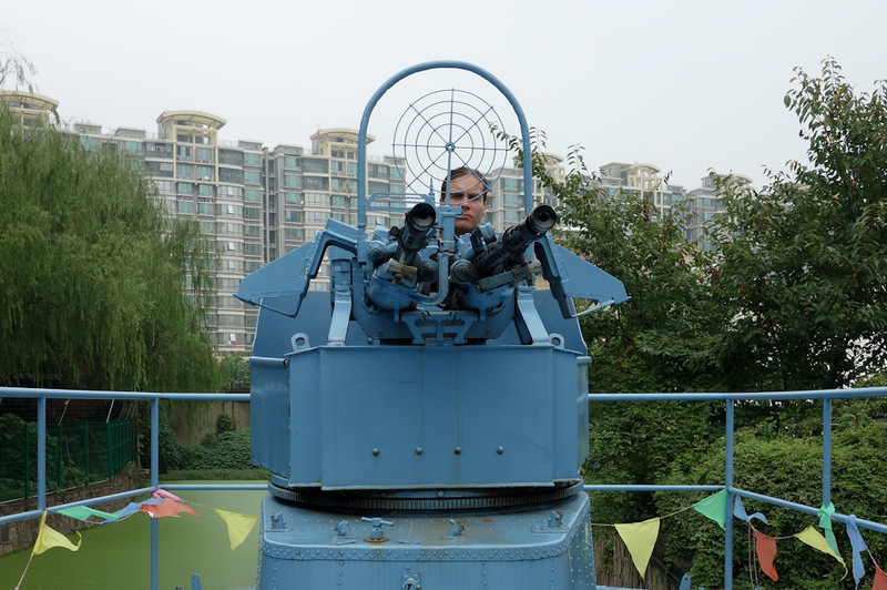 China-Shanghai-Museum-Amusement Park - Despite being an aerospace park, they have a torpedo boat floating in an algae filled swamp. I climbed aboard to fire the gun. People thought I was qu