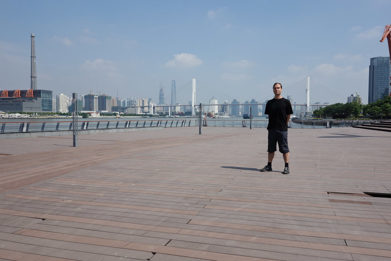 China-Shanghai-Expo-Ferry - Its me in the abandoned water front area. You can see one of the holes down to the water below in the foreground. It is a spooky place being there on