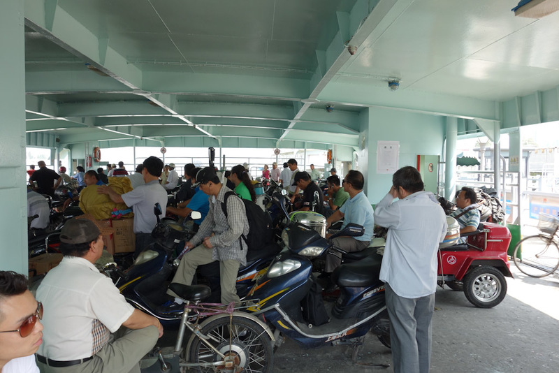China-Shanghai-Expo-Ferry - The ferry caters pretty much just for scooters, they are not allowed to use the enormous bridge which looms large overhead.