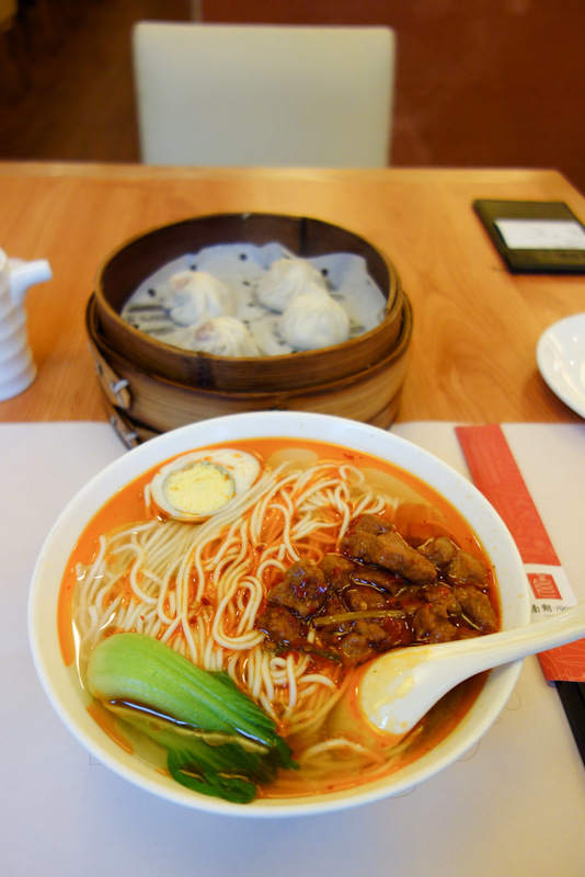 China-Shanghai-Market-Airport - My last meal, noodles and dumplings from 1900. This time the noodles come with pork and chilli oil. The dumplings are 2 normal pork ones and 2 crab on
