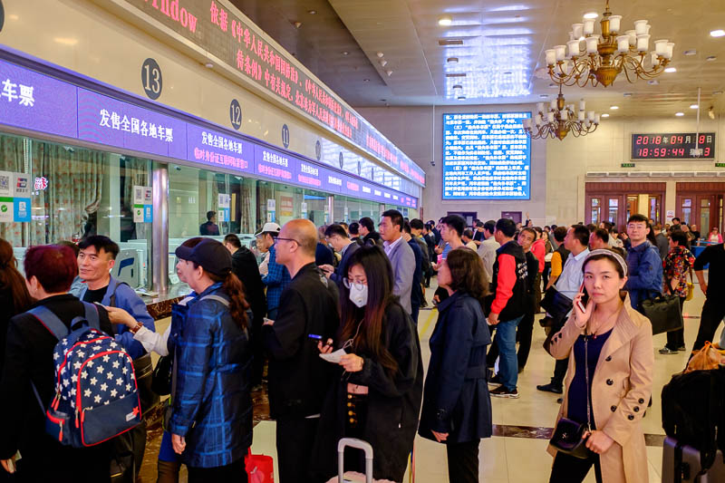 China-Beijing-Food-Architecture - I came to Beijing station to make my ticket exchange. The line experience in a Chinese train station is about as you would expect. I told a few line c