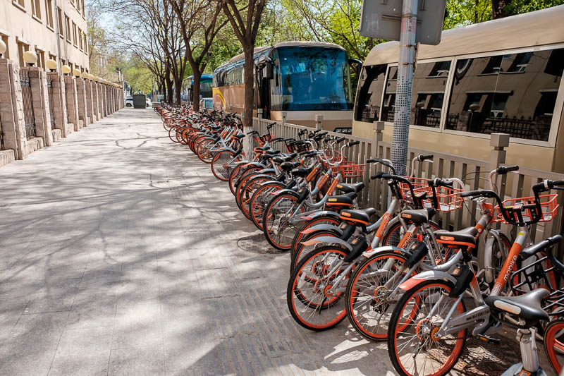 China-Beijing-Wangfujing-Sunshine - Here is the competing orange brand of dockless bicycles. Now there definitely seems to be some form of organisation going on, they seem to have turf a