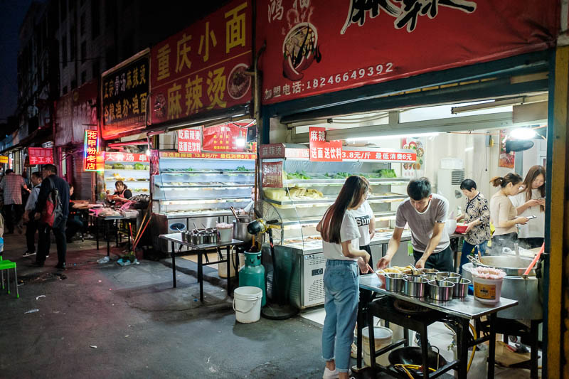 China-Zhengzhou-Mall-Pedestrian Street-Food - There are lots of alleyways filled with food carts and little food stands such as this, 3 identical ma la tang shops in a row. They didnt really have