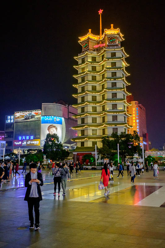China-Zhengzhou-Mall-Pedestrian Street-Food - This is Erqi square monument, it was constructed to memorialize a labour strike in 1927. I assume many people died. Nothing much of significance happe