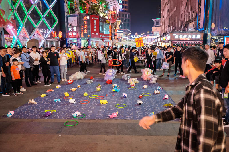China-Zhengzhou-Mall-Pedestrian Street-Food - On the way back I decided to stop and lose all my money throwing neon hoops at plush toys.