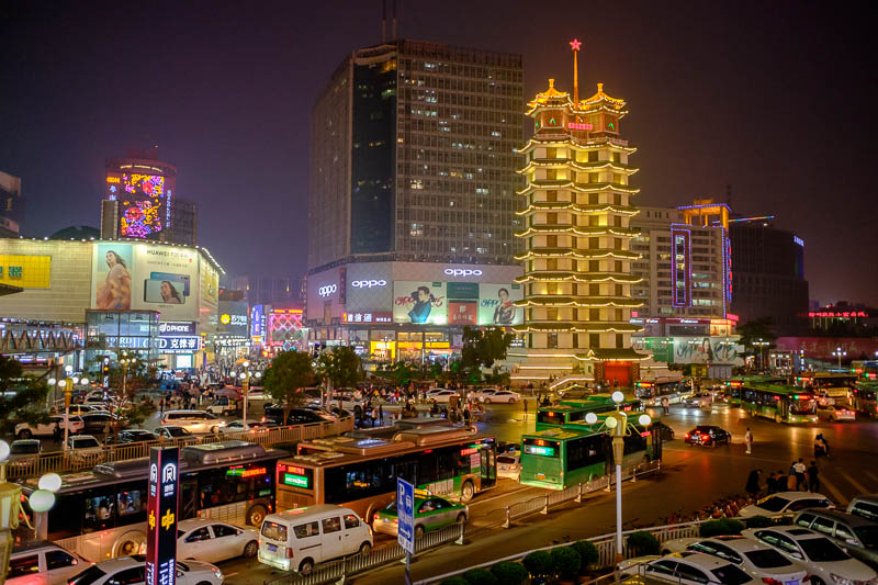 China-Zhengzhou-Food-Erqi Square - Here we have the busy Erqi square and tower, looking back towards the old side of town from a road overpass, with all the neon from the pedestrian str
