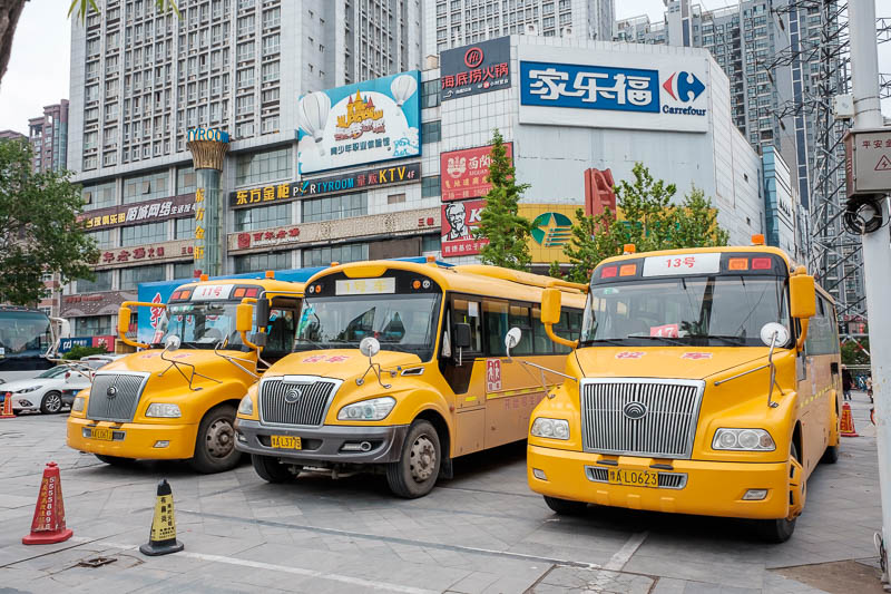 China-Zhengzhou-Park-Mall-Walk - 3 electric long nose school buses. So much of everything is electric, you have to be really careful crossing roads and footpaths because you cant hear