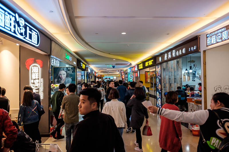 China-Zhengzhou-Food-Mall - Then I headed to the basement, there had to be 100 casual eating places down here. Lots of them dessert focused but also dinner places with benches an