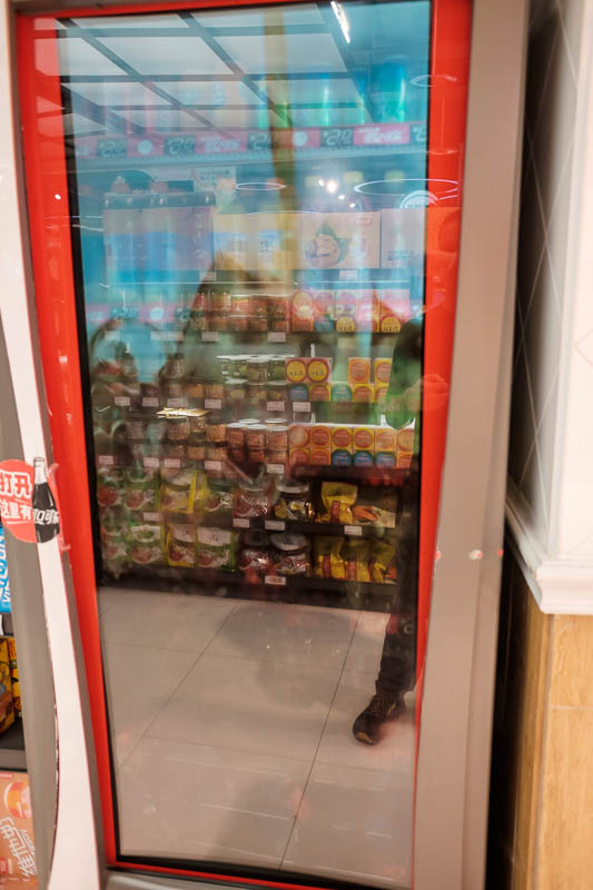 China-Zhengzhou-Food-Mall - Now this is a crap photo, but its here because of the technology. Inside the door of this coke fridge is a semi translucent full motion screen showing