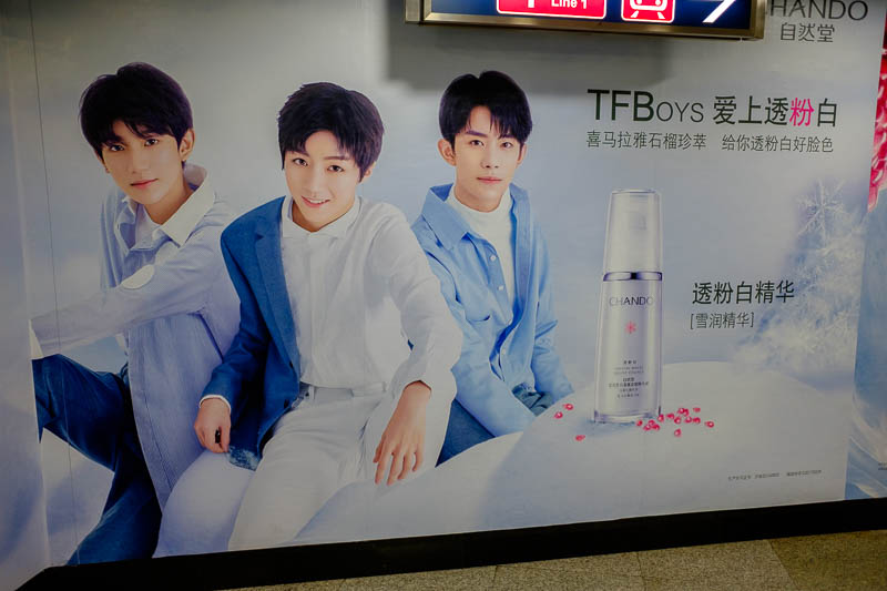 China-Beijing-Xidan-Food - It's the famous TFBoys, what are they selling? Face whitening cream. Everybody wants to be white.
