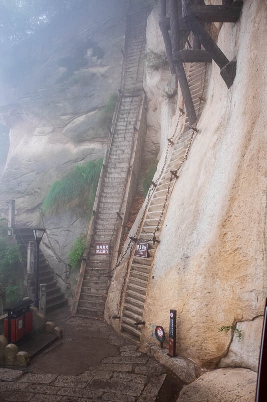 China-Hiking-Rain-Huashan-Soldiers Path - This is a famous spot on the trail, the 80 degree steps. As you can see theres a couple of different options for how steep you want to go. Also note t