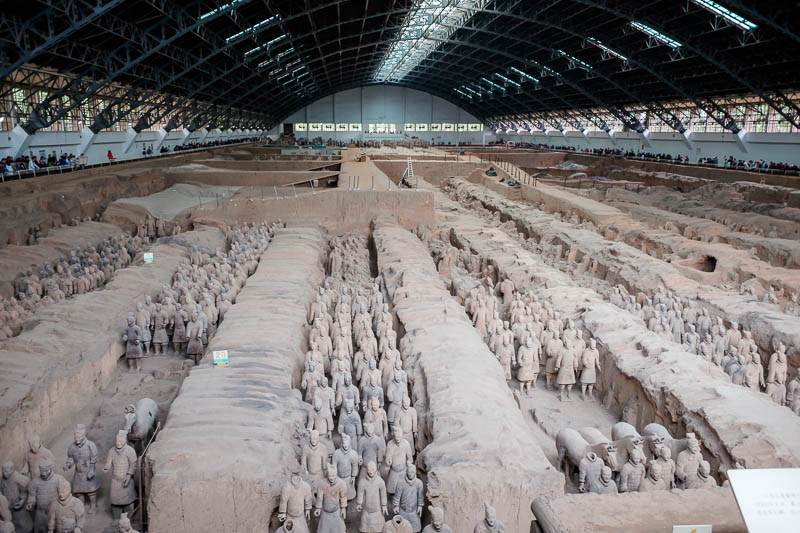 China-Xian-Terracotta Army - And here they are. Everyone has seen the photo before. The shed over the top is also impressive. I believe the roof of the tomb was originally just ab