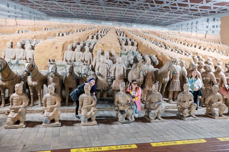 China-Xian-Terracotta Army - If you pay enough money you can have your photo taken with a mummified warrior.