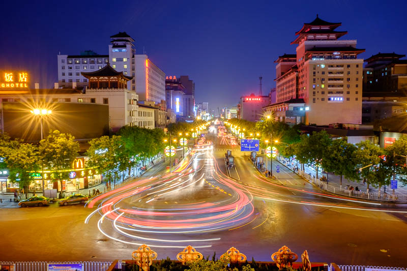 China-Xian-City Wall-Hiking-Dumplings - Here we have a long exposure looking south from the old train station. Buses do a U turn here, hence the cool light trails.