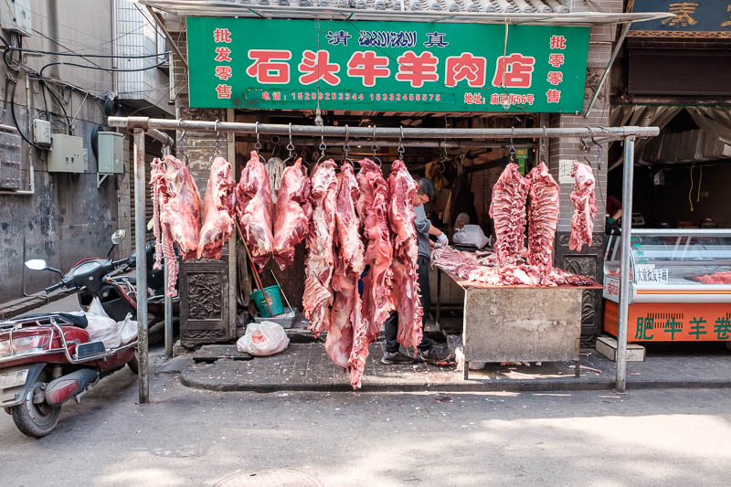 China-Xian-City Wall-Muslim Quarter - Just one of about 50 butcher shops airing their delicious meats.