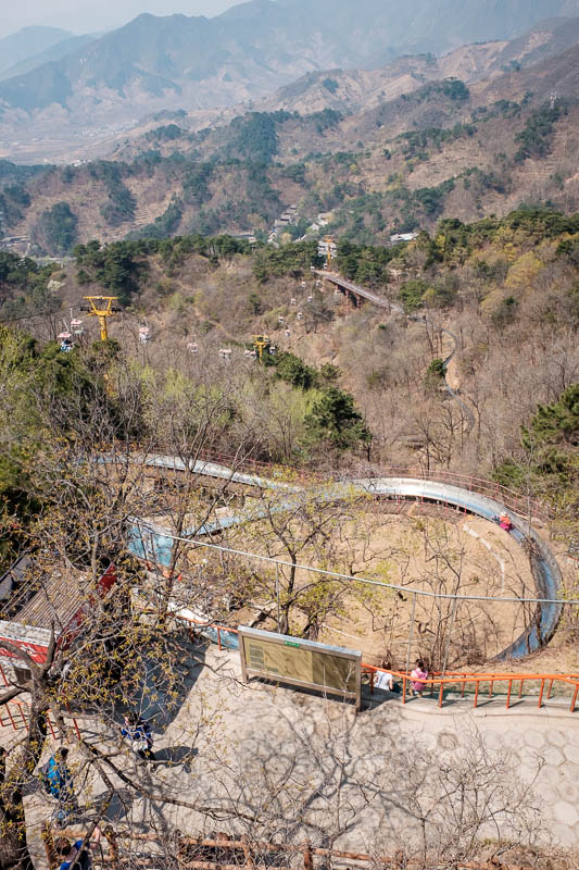China-Great Wall-Mutianyu - Here is the luge track. Lots of people take the chair lift up, walk a hundred metres, take the luge track down.