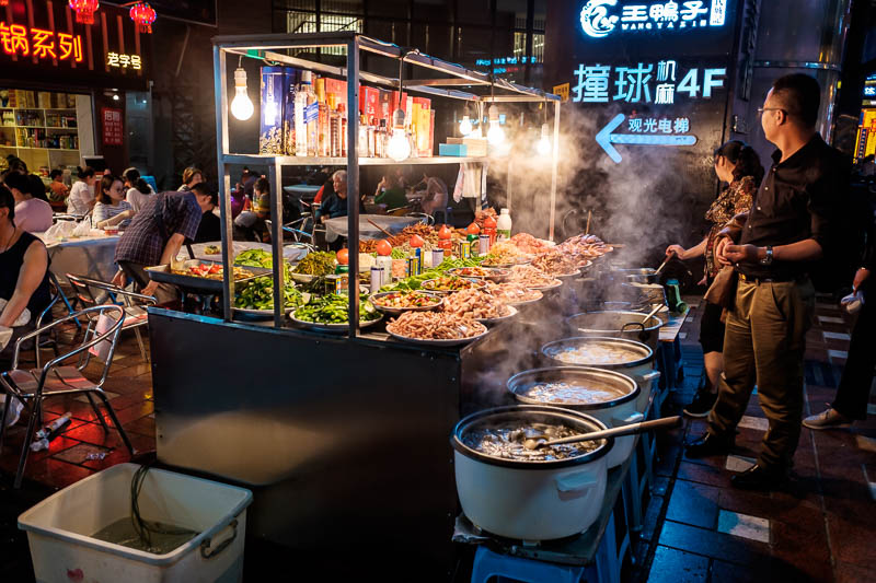 China-Chongqing-Hongyadong-Jiefangbei - If you want something a bit different, theres a salad bar surrounded by boiling cauldrons of chilli in the street.
