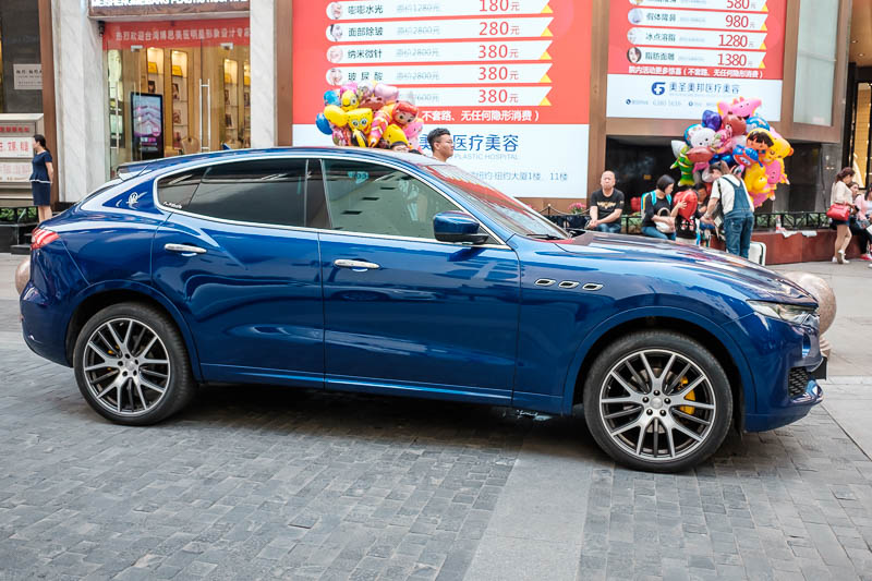 China-Chongqing-View-Hongyadong - If you are ever wondering why Maserati / Jaguar / Bentley / Porsche make these hideous SUV's and Ferrari and Lamborghini are following with things tha