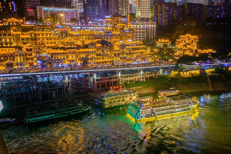 China-Chongqing-View-Hongyadong - Heres a lit up boat. And the cave tourist cliff area in the background.