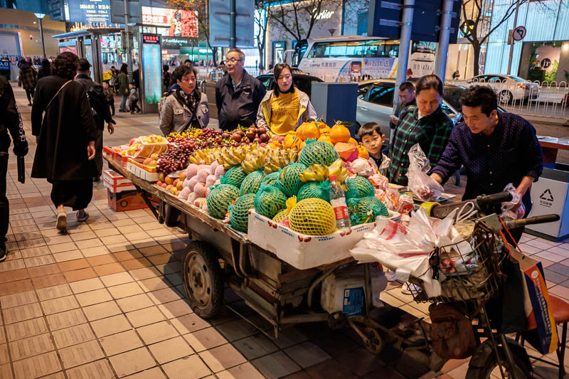 China-Beijing-Food-Wangfujing - You can still also find fruit sellers with their carts. It all looks amazing, but I can only eat fruit if its been cut up for me and put in plastic, l