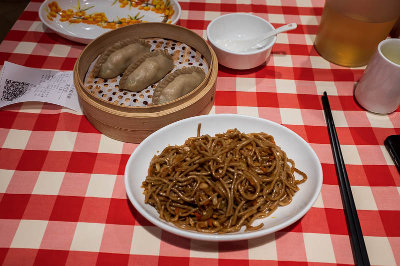 China-Beijing-Food-Wangfujing - Here is my dinner, the above mentioned not cold noodles and some dumplings that were filled with scrambled egg and pickled vegetables. Very nice but I