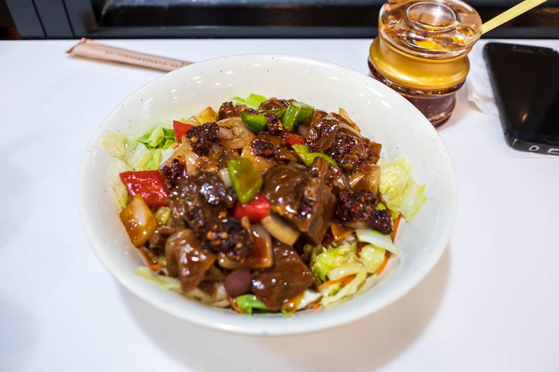 China-Hangzhou-West Lake-Temple of God - I found a popular place for dinner, sat at a bar, decided to not have beef noddle soup. This was labeled as exotic sirloin with pickled vegetables on