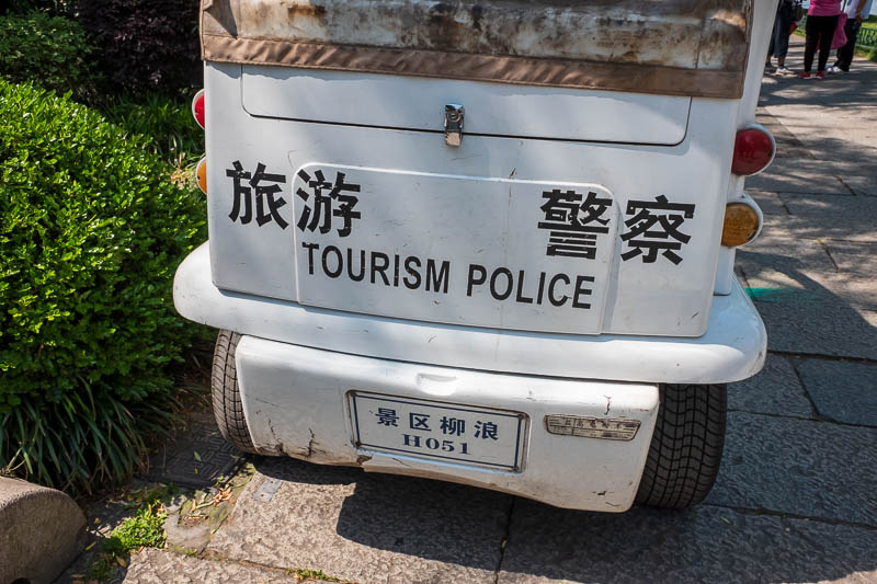 China-Hangzhou-West Lake-Hiking - Law & Order: Tourism Police. Theres a special police force for everything. There job, to scream at people who dare to walk on the grass. Really, that