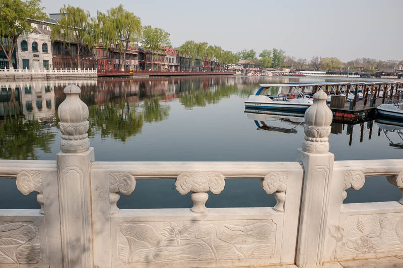 China-Beijing-Summer Palace - Unfortunately I was too early to rent one of these boats, but the attendants in their blue overalls stood to attention and sang an old sea shanty as t