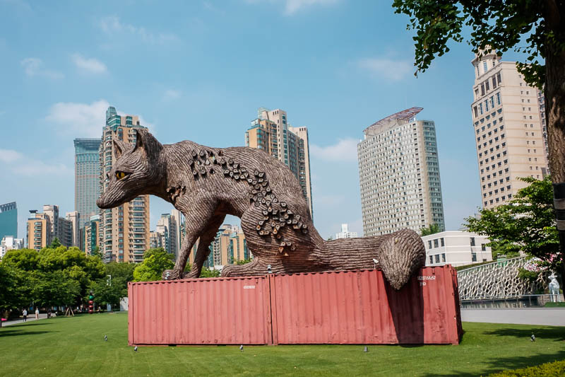 China-Shanghai-Park-Yuyuan Garden - A rabid wolf. Those are full sized shipping containers it is sitting on.