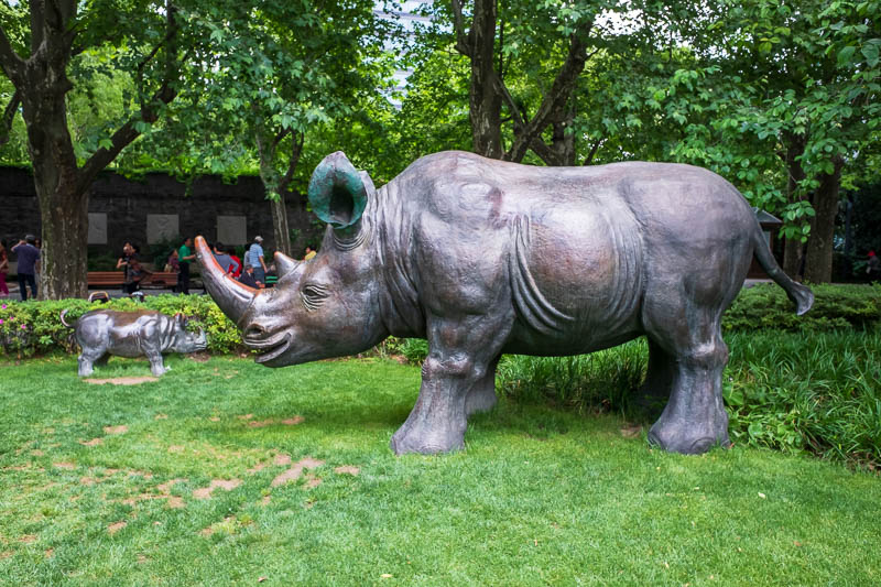 China-Shanghai-Park-Yuyuan Garden - Over the road from the golden temple is another park, where you can admire a family of petrified rhinoceroses. The grass police blew their whistle at