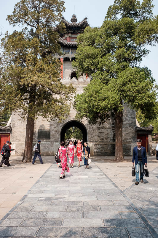 China-Beijing-Summer Palace - Now we leave the lake and head into palace world, here is a gate and some ladies who have dressed up for the occasion.