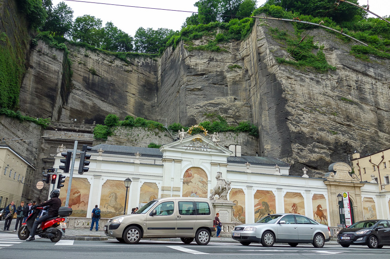 Austria-Salzburg-Mozart-Sausage - And a facade for the cliff paying tribute to horses that haul Chinese tourists around Salzburg for only 200 euros for 5 minutes.