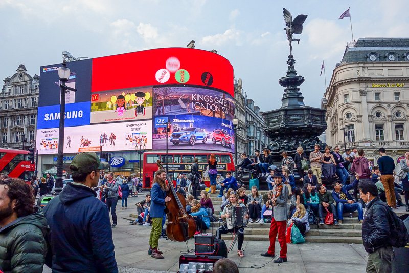 England-London-China Town-Picadilly Circus - And a gypsy band distracting people whilst their children pickpocketed the tourists.