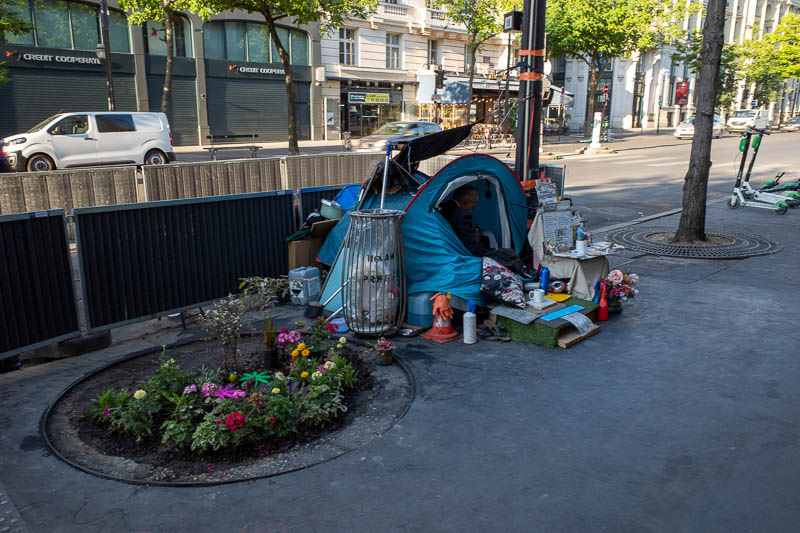 France-Paris-Sightseeing - This guy has quite the setup. A little tent, some fake grass, his own rubbish bin and garden. I dont even get a garden in my very expensive tiny shoe